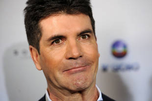 Simon Cowell Admits He's Torn Between Four Girls