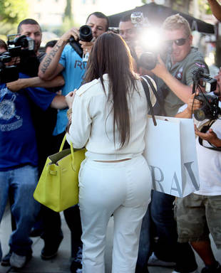 Answer: The Celeb in White Revealed!