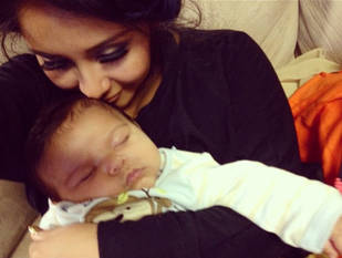 Snooki Cuddles With Baby Lorenzo After One Night Away From Her Boys (PHOTO)