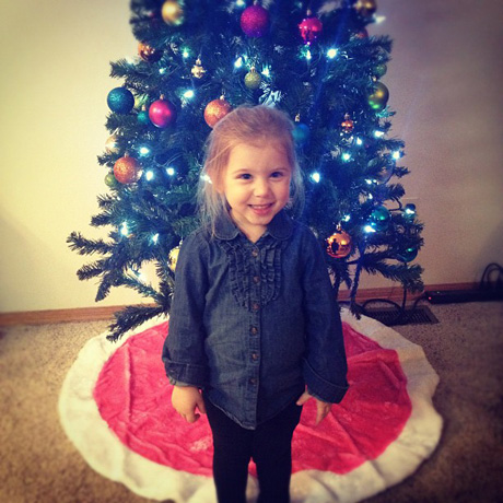 Aubree Houska Strikes a Pose in Front of the Christmas Tree — Adorable Alert!
