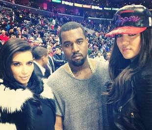 The Kardashian Family — And Kanye West — Celebrate Christmas at LA Clippers Game!