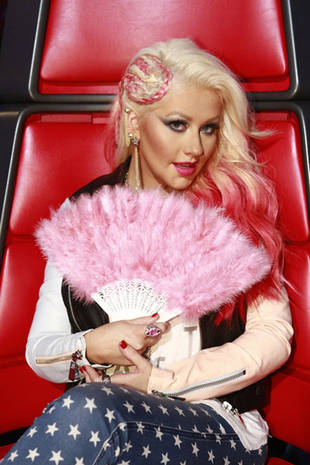 Why Does Christina Aguilera Use a Fan?