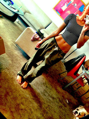 Another Day, Another Strange Twitter Photo of Miley Cyrus Baring Her Abs in Baggy Pants