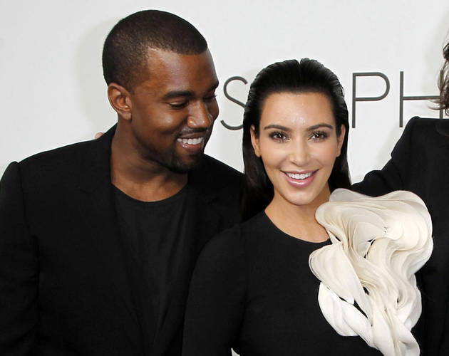 """Kanye West Parties With Leo DiCaprio, While Kim Kardashian Tweets That She Misses Her """"Prince"""""""