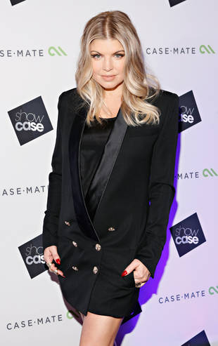 Fergie Admits She's Heavier But Not Pregnant
