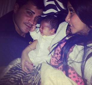 Snooki's First Family Photo! Jionni, New Baby Lorenzo, and Snooki Pose in Bed (PHOTO)
