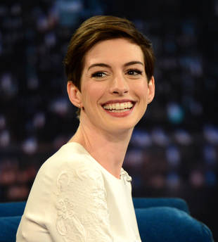 "Anne Hathaway on Baby Plans: ""I'd Like to Have a Few Naturally and Adopt"""