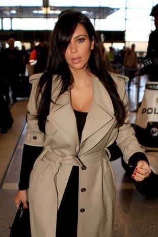 Pregnant, Make-up Free Kim Kardashian Jets Off to Africa!