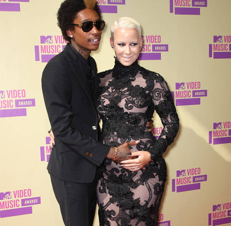 Pregnant Amber Rose and Wiz Khalifa Are Apparently Married! — Report