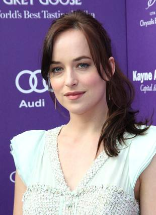 "Fifty Shades of Grey Star Dakota Johnson Having ""Tough"" Time With Fame"