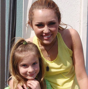 Brighton Sharbino Poses With Miley Cyrus in Flashback Photo
