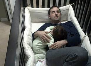 Dad Climbs Into Crying Daughter's Crib (VIDEO)
