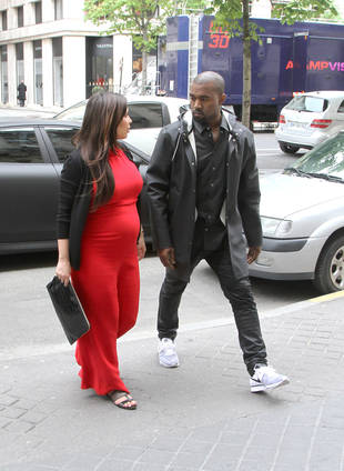 Exclusive! Kim Kardashian Giving Birth in Paris? Kim's Friend Says…