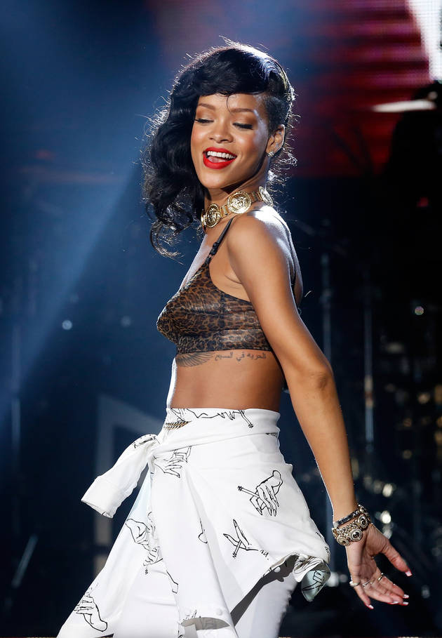 Rihanna Strikes Clingy Fan With Her Microphone! (VIDEO)