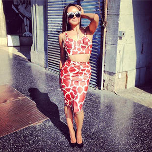 "Kat Graham ""Shooting Something Major"" in Sexy Giraffe Print Bustier (PHOTO)"