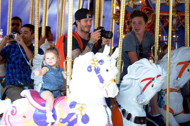 David Beckham and the Kids Enjoy the Carousel at Disneyland (PHOTO)