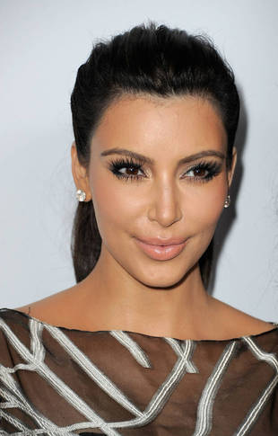 Kim Kardashian's New Look: Is Kanye West Making Her Over in Beyonce's Image?
