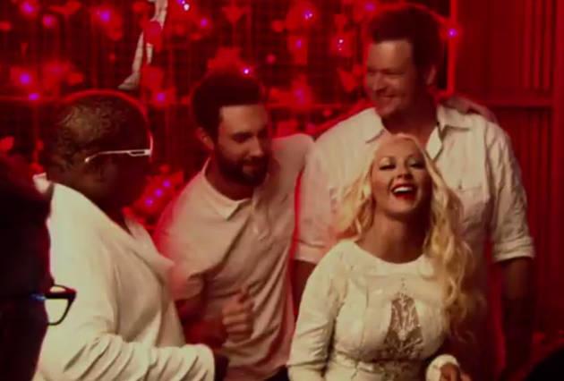 Christina Aguilera Spanks Adam Levine With Her Fan in New Voice 2013 Promo (VIDEO)
