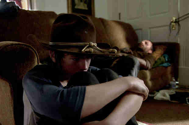 The Walking Dead Season 4, Episode 9 Photo: Injured Rick Sleeps, Intense Carl Just Stares
