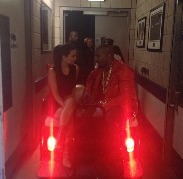 "Kim Kardashian, Kanye West on Valentine's Day: ""A Thousand Roses,"" One Weird Bed Pose (PHOTOS)"