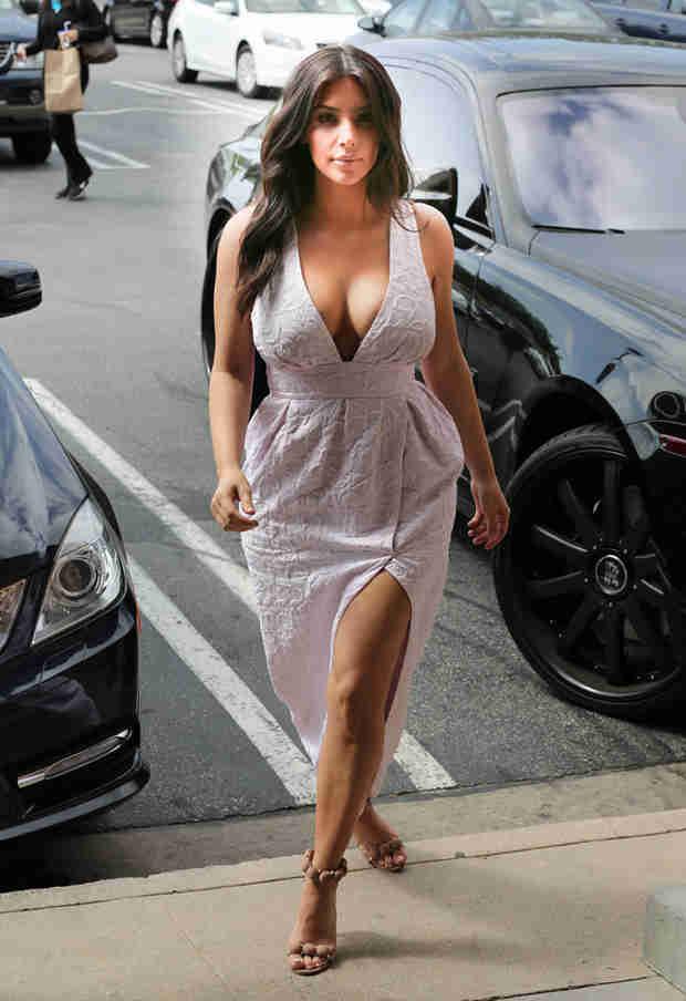 Kim Kardashian Flaunts Crazy Cleavage, Lots of Leg in a Thigh-High Slit Dress