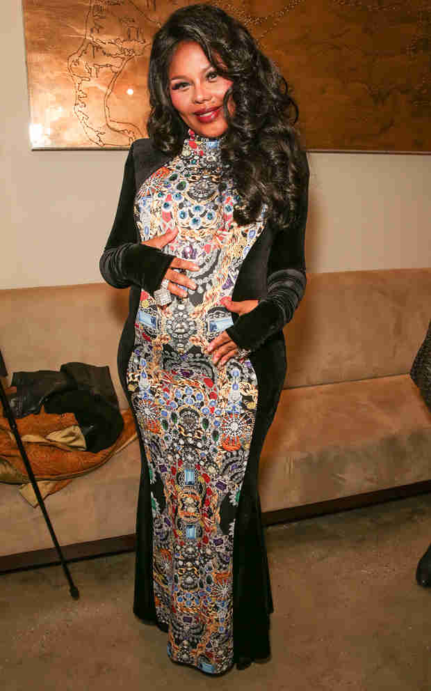 Pregnant Lil' Kim Officially Announces She's Having a…