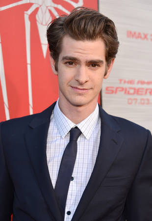 "Andrew Garfield Shaves Head, Appears in Drag For Arcade Fire's ""We Exist"" Video"