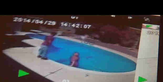 "Dad Caught on Camera Throwing Toddler into Swimming Pool to ""Teach Her a Lesson"""