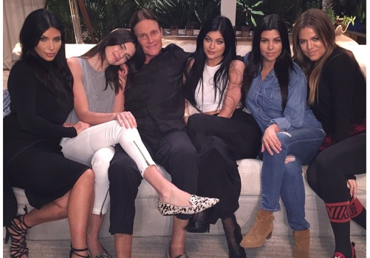 Bruce Jenner Poses With Daughters