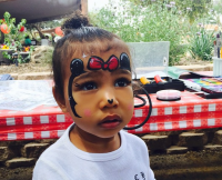 North wears a bun and Minnie Mouse face paint.