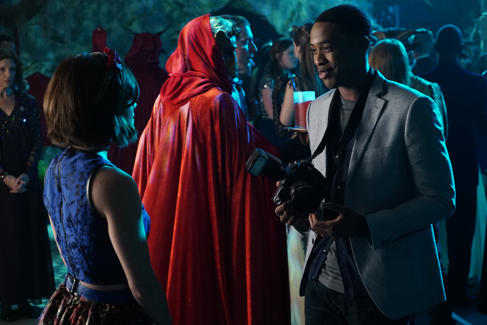 Aria, Clark, and Someone in Red in on Pretty Little Liars Season 6, Episode 9