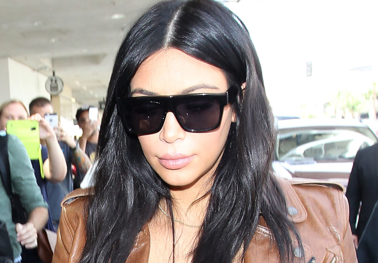 Kim Kardashian departs from the Los Angeles International Airport***NO DAILY MAIL SALES***